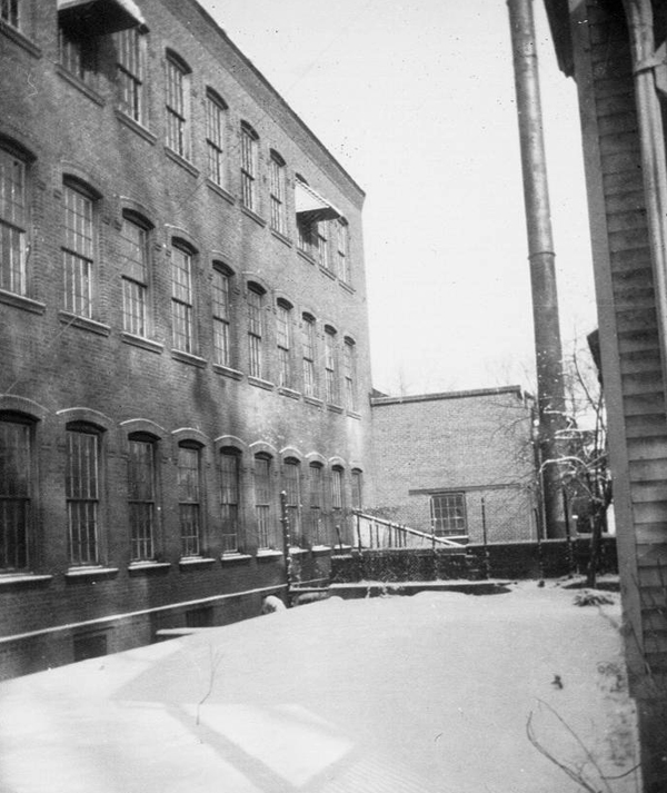 Photo taken in 1952 showing east side of factory with 90ft boiler chimney.